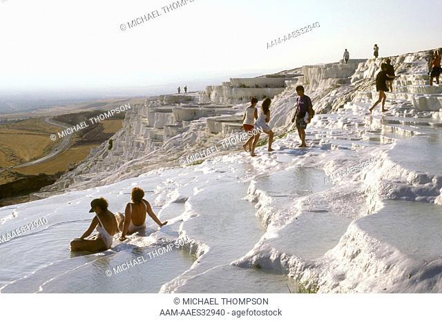 Tourists enjoying Calcium rich Hot Springs, Pamukkale N.P., Turkey