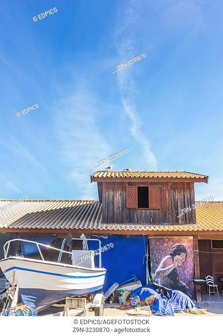 fishing boat and fishermen's hut, alvor, algarve, portugal