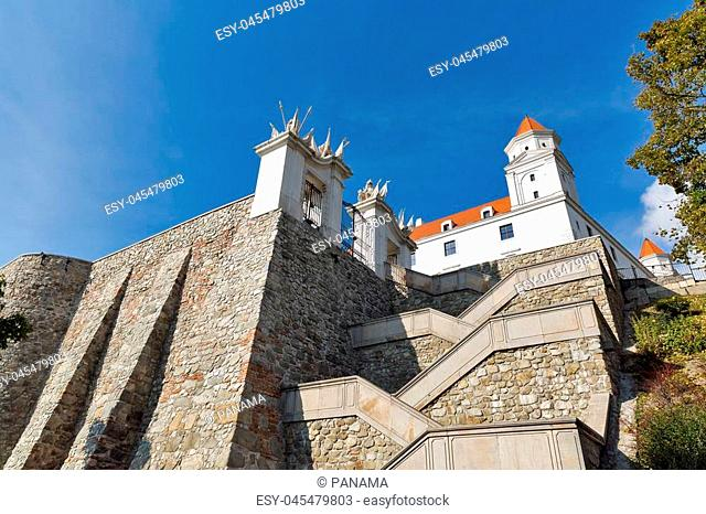 Gate, tower and stairs to the Bratislava Castle against clear blue sky, Slovakia