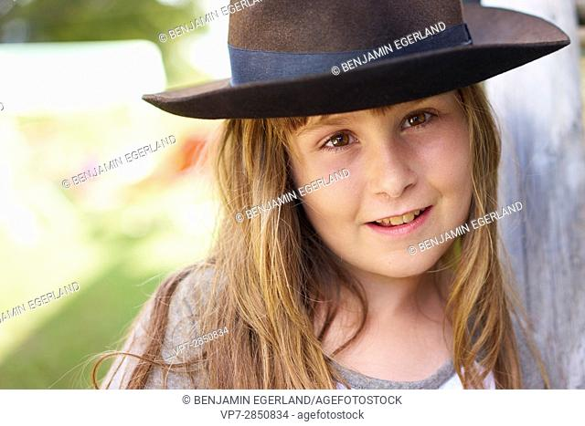 Playful young girl with hat