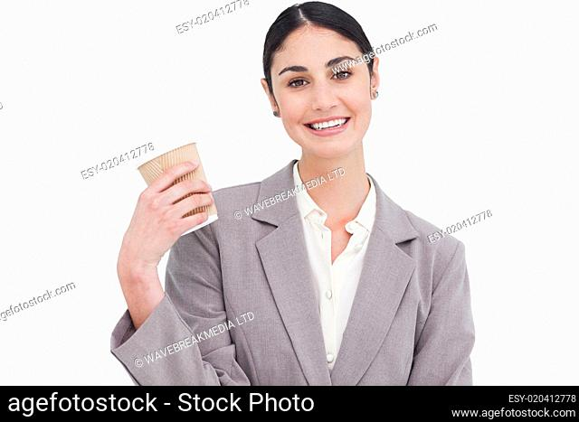 Smiling businesswoman with paper cup