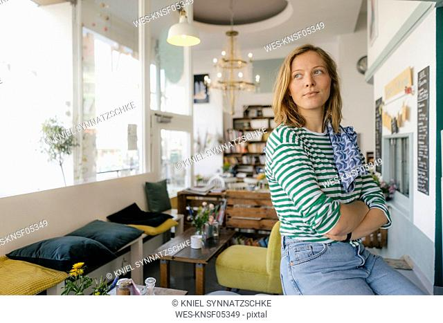 Young woman in a cafe looking sideways