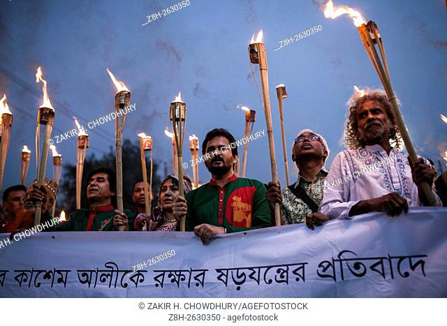 DHAKA, BANGLADESH - MARCH 06 : Members of Ganajagoron Mancha and cultural activists attend a torch procession demanding the implementation of the death sentence...