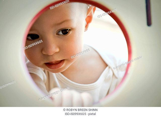 Little girl looking through circle