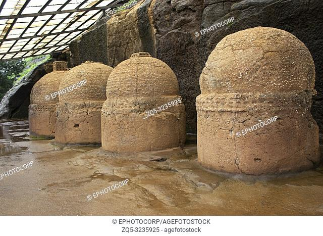 Votive stupas also called as memorial stupas on the way to cave No. 20, Bhaja caves, circa 150 B. C. Pune district, Maharashtra India