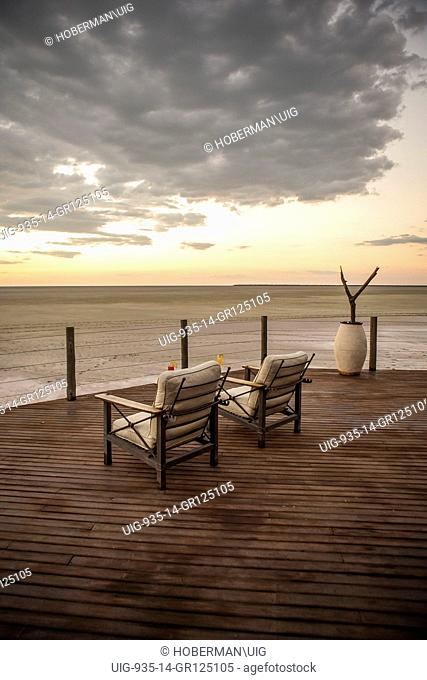 Deck Chairs With Sunset Views Over Etosha Pan In Namibia