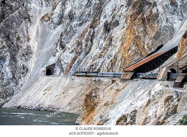 Passenger train about to go through a tunnel in the Thompson River Canyon in British Columbia, Canada