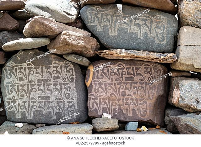 Mani stones with inscriptions. Trekking in Markha valley (Laddakh, India)