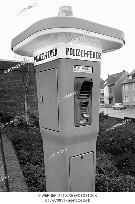 Seventies, black and white photo, emergency telephone to the police and to the fire brigade