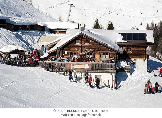 Rauris Austria Europe / January Skiers in Bergrestaurant wooden chalet on pistes in ski resort in Austrian Alps in winter snow