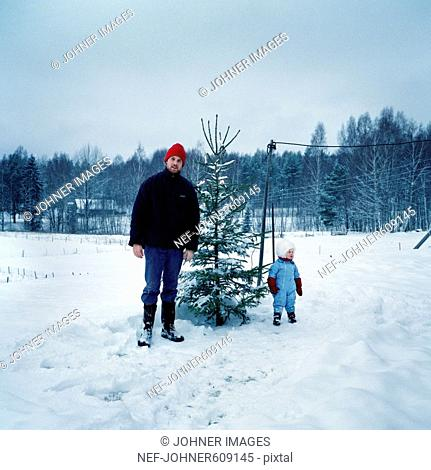 Father, daughter and Christmas tree, Dalarna, Sweden