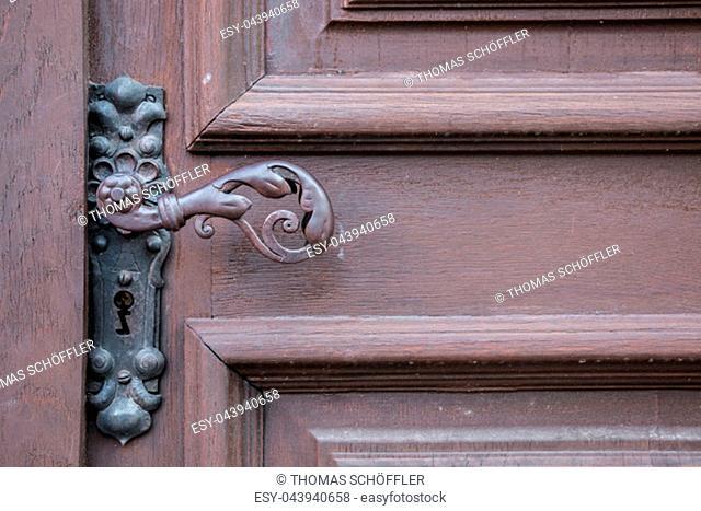 Iron door handle of an old door of a historical building