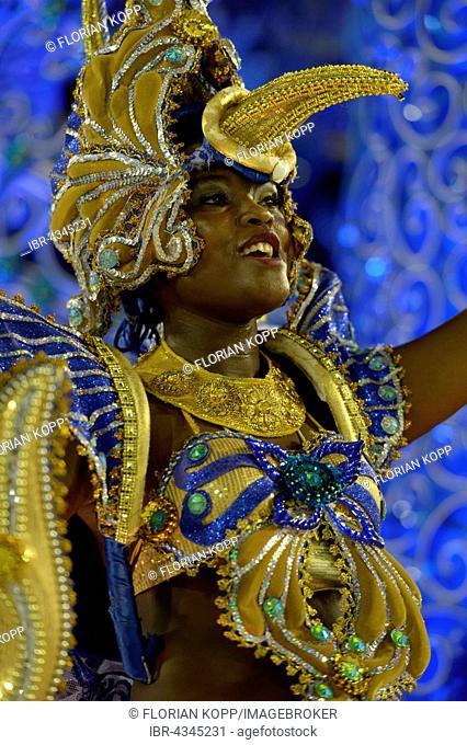 Samba dancer on an allegories float dressed as a Hummingbird, parade of the Samba school Beija Flor de Nilópolis, Carnival 2016 in the Sambadrome