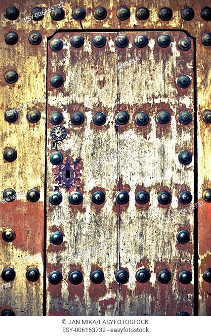 Abstract photo of weathered ancient wooden door