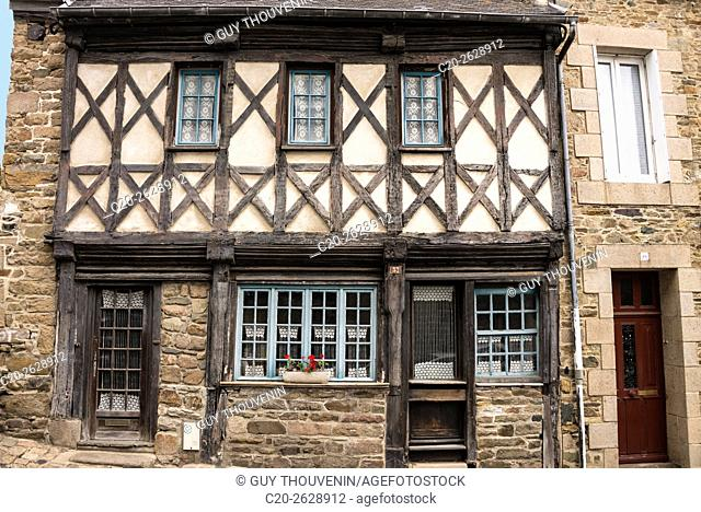 Typical medieval facade, windows painted in blue, stone arches, breton style, B and B, old townTreguier, Cotes d'Armor, 22, Brittany, France