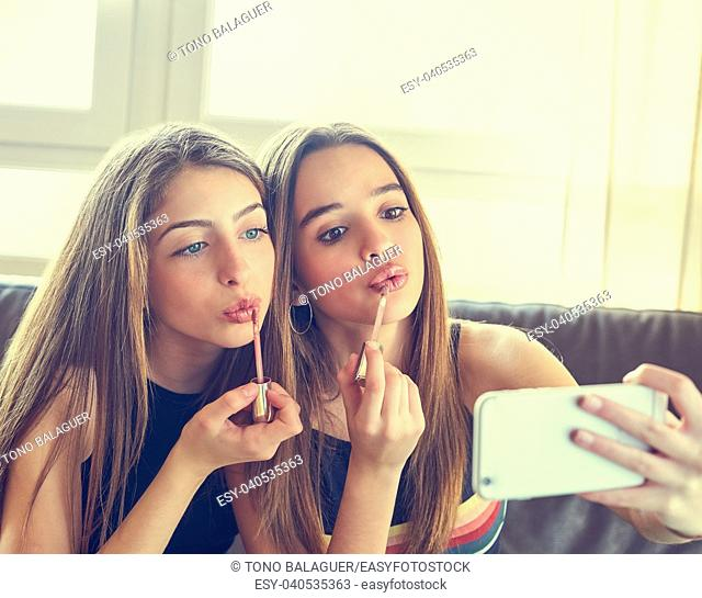 Teenager girls best friends makeup selfie camera in smartphone make-up