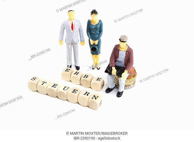 Miniature figures, letter cubes forming the words Erbe and Steuern, German for inheritance and taxes, symbolic image for inheritance tax