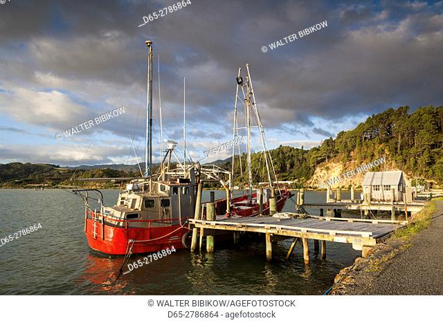 New Zealand, North Island, Coromandel Peninsula, Coromandel Town, commercial wharf, sunset