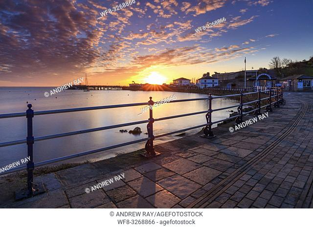 Sunrise captured from Swanage promenade on Dorset's Jurassic Coast, with the restored Victorian seaside pier in the distance