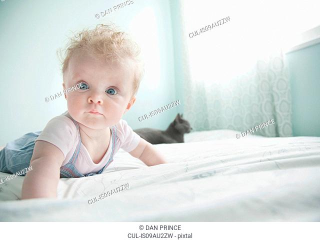 Portrait of baby girl lying on front