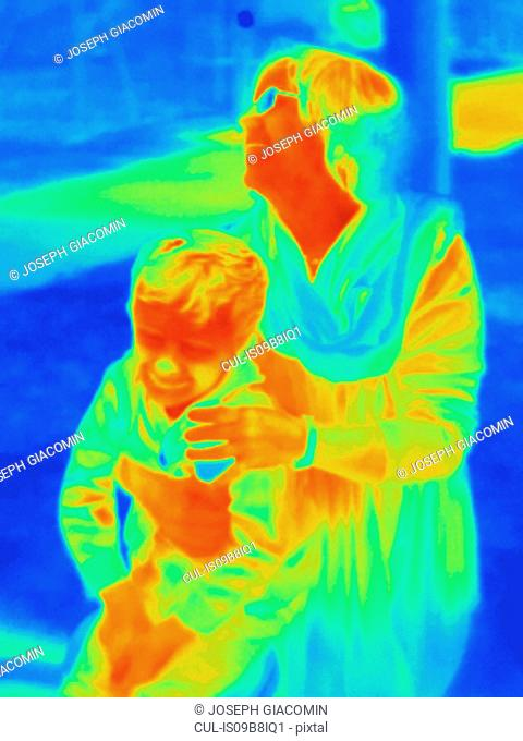 Thermal photograph of mother and son in park