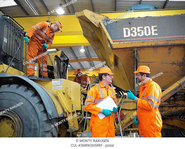 Engineers teaching apprentices on truck