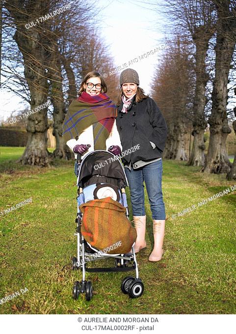 women walking baby in country