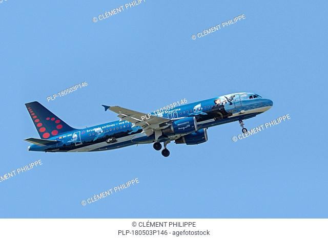 Airbus A320-214 in Magritte livery, narrow-body, commercial passenger twin-engine jet airliner from Belgian Brussels Airlines in flight