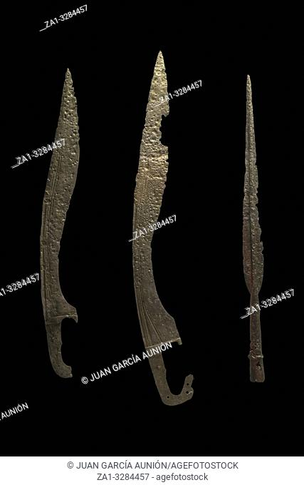 Cordoba, Spain - Sept 7th, 2018: Iberian weapons. Falcata swords and spear point. Isolated