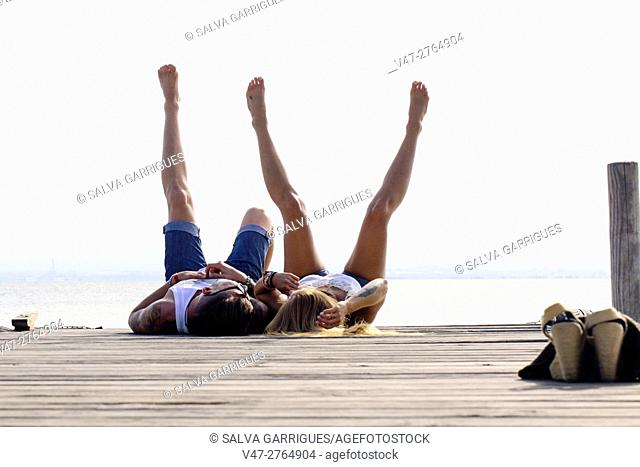 Bridal couple lying on the pier of Lake Albufera of Valencia, Spain, Europe