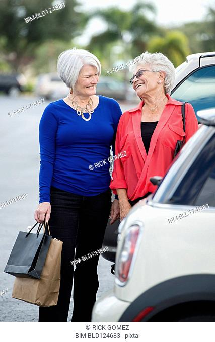 Senior Caucasian women with shopping bags in parking lot