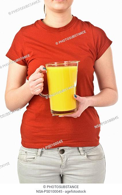 Girl in red shirt holding a glass of orange juice