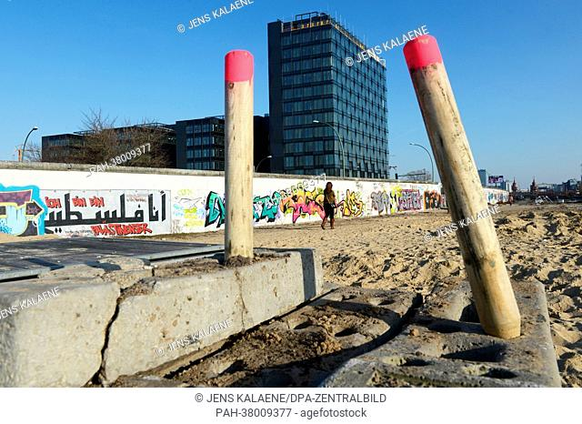 View of construction site barriers and a cleared area on the western side of the Berlin Wall at East Side Gallery in Berlin, Germany, 07 March 2013