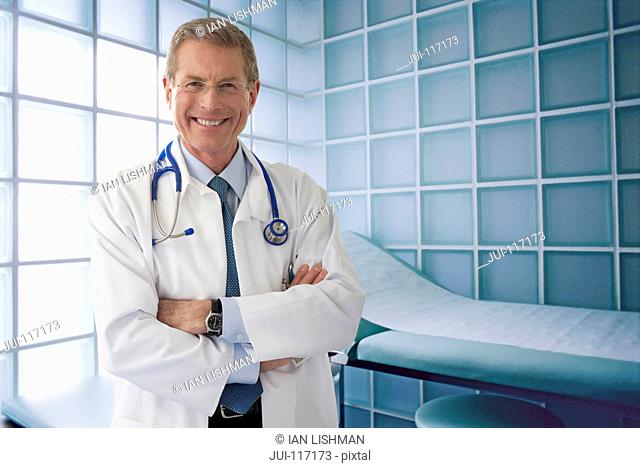 Portrait Of Hospital Doctor In Examination Room