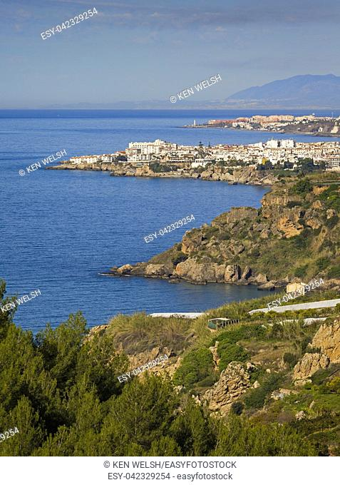 Nerja, Costa del Sol, Malaga Province, Andalusia, southern Spain. View from near Maro across fields to Nerja with the lighthouse of Torrox Costa visible behind
