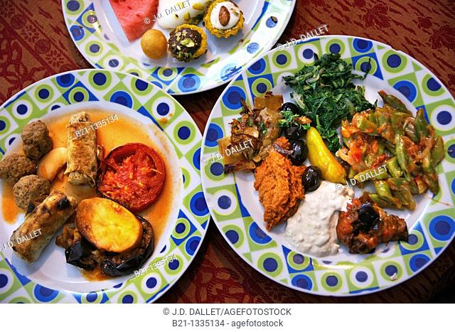 Food: meat balls with fried rolls and aubergines, 'meze' salads and sweets with fruits, Damascus, Syria