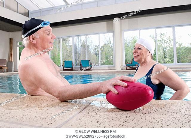 Couple smiling in a swimming pool