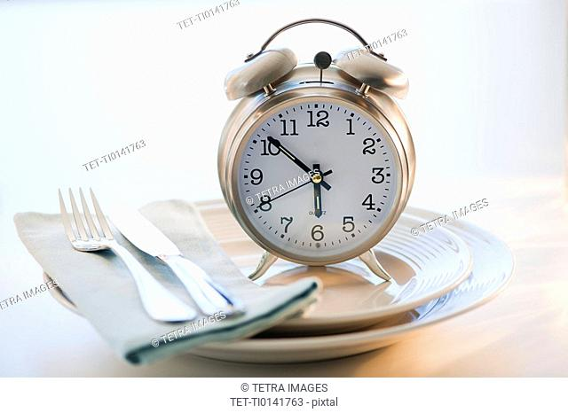 Alarm clock on plate