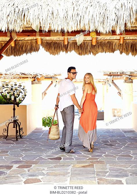 Couple walking under awning outdoors