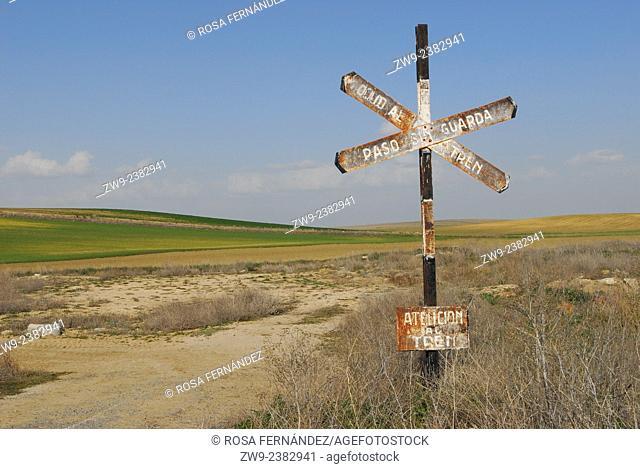 Landscape with ancient railroad crossing sign, province of Salamanca, Castilla y Leon, Spain