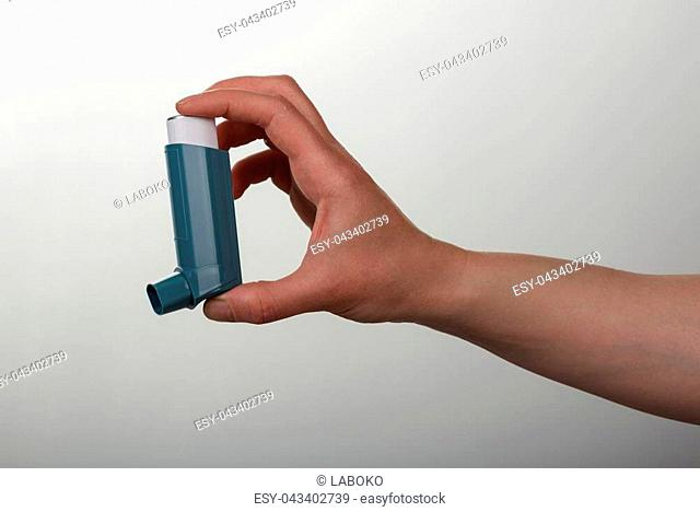Pocket inhaler is ready for work, on gray background