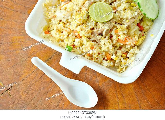 fried rice with pork for take home packing in white foam box and plastic spoon