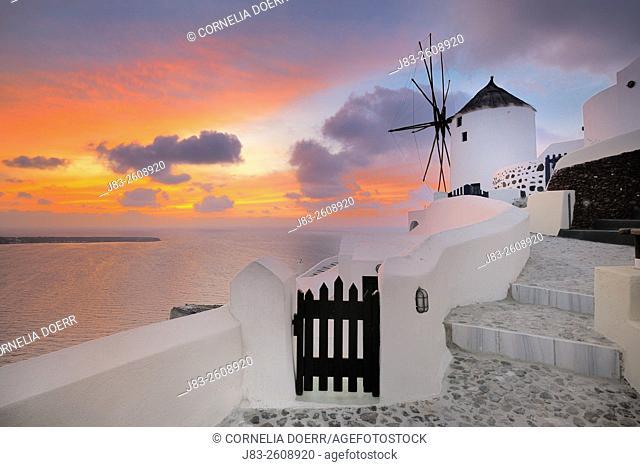 Traditional Greek windmill of Santorini at sunset, Oia Village, Santorini, Aegean Island, Cyclades Islands, Greek Islands, Greece, Europe