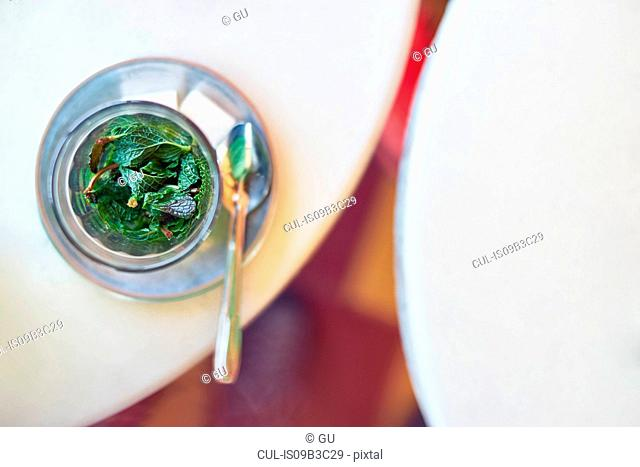 Overhead view of a glass of mint tea, Marrakech, Morocco