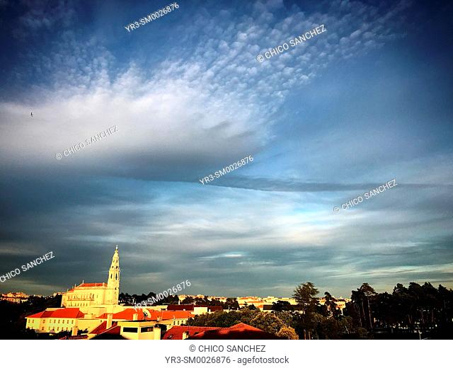 Clouds cover the Sanctuary of Our Lady of Rosary at sunset in Fatima, Portugal