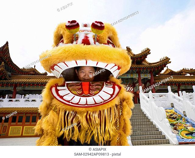little boy inside of Chinese lion dance costume