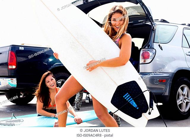 Female friends with surf boards, Hermosa Beach, California, USA
