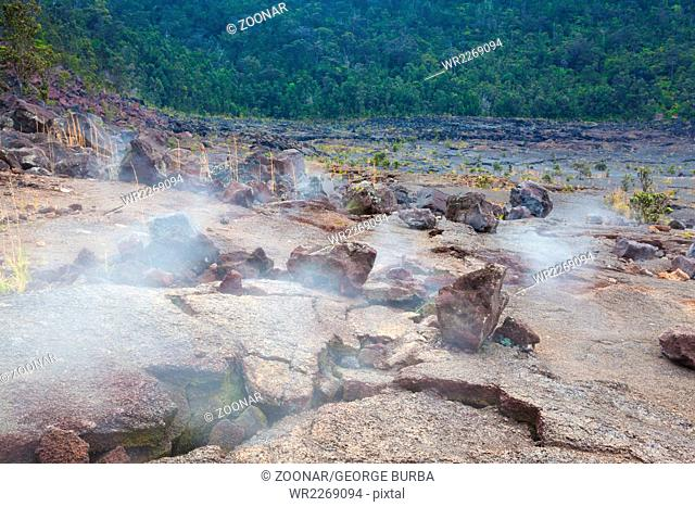 Barren bottom of Kilauea Crater with sulfur gas vents in Hawaii Volcanoes National Park
