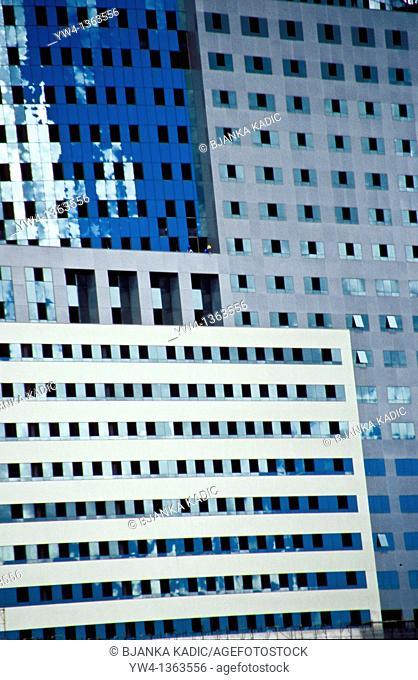 Modernist architecture with two tiny workmen, Brasilia, Brazil