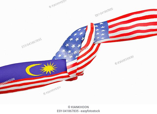 Helping hands of United States of America and Malaysia with flags painted on child's hands in isolated white background